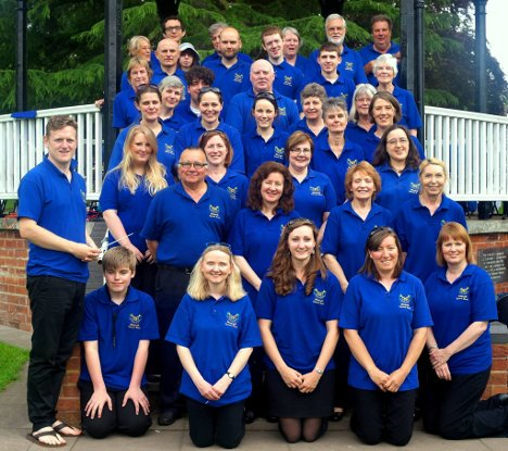 The players of Blackwell Concert Band fill the steps of the bandstand at Droitwich Lido Park (1 June 2014).